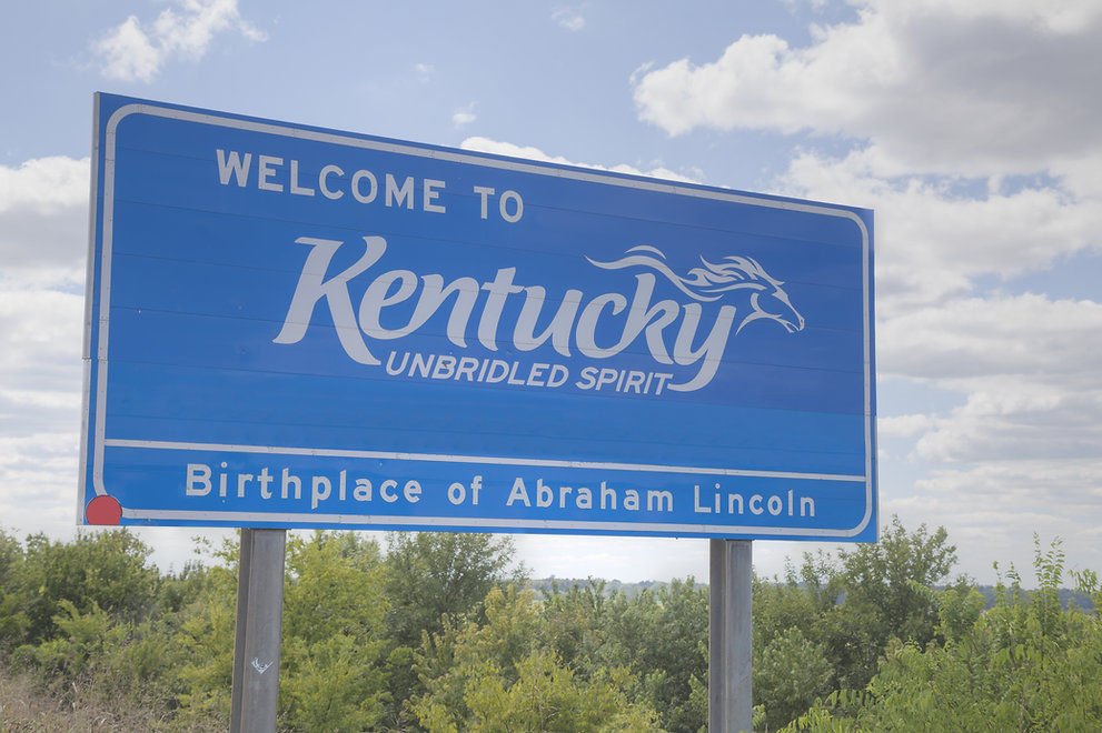 Welcome to Kentucky road sign at the sta