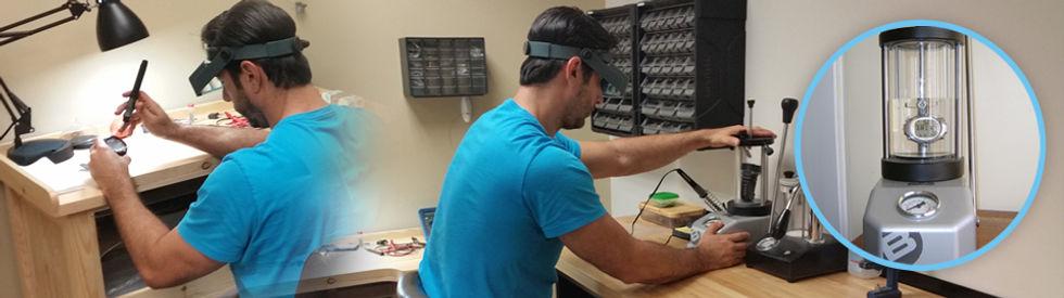 Technician pressure testing dive computers in Fort Lauderdale, FL