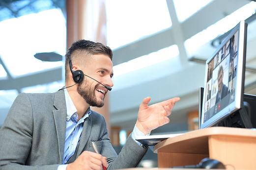 Businessman speak talk on video call wit