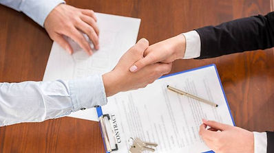 shaking-hands-over-a-signed-contract.jpg