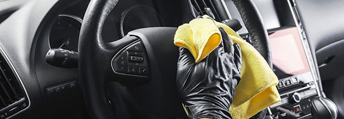 bigstock-A-Man-Cleaning-Car-With-Yellow-