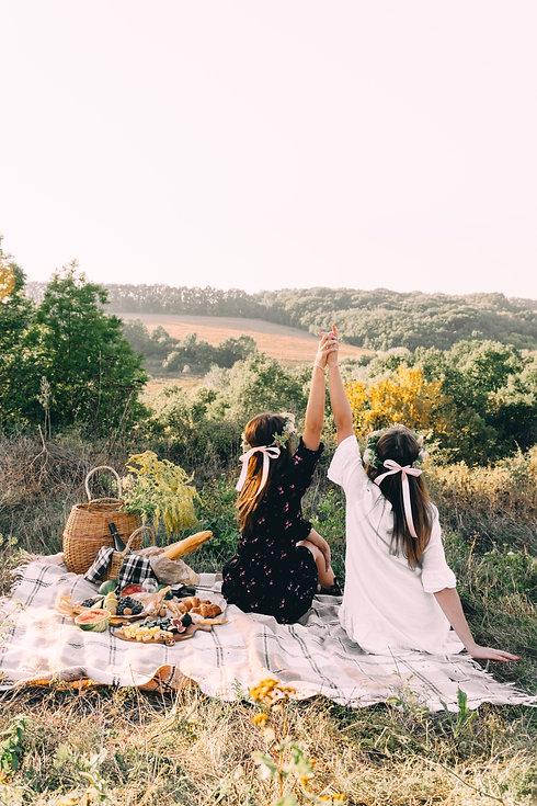 Two best friends on picnic in hte field
