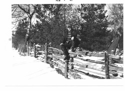 Dos Snowden on fence between 50-52 and Touts Grove February 1965.jpg