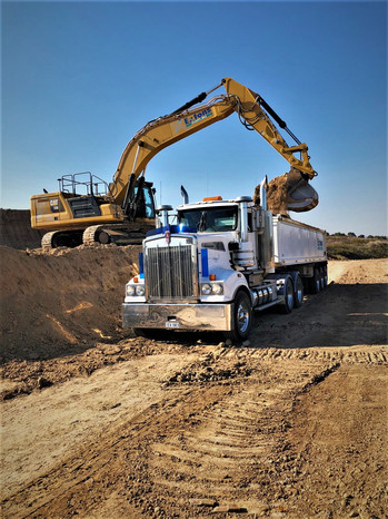 Truck loading clay liner.jpeg