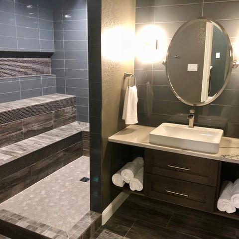 Finished Basement | Bathroom | Double shower | shower bench