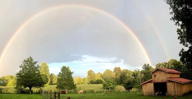 Barn and rainbow Photo