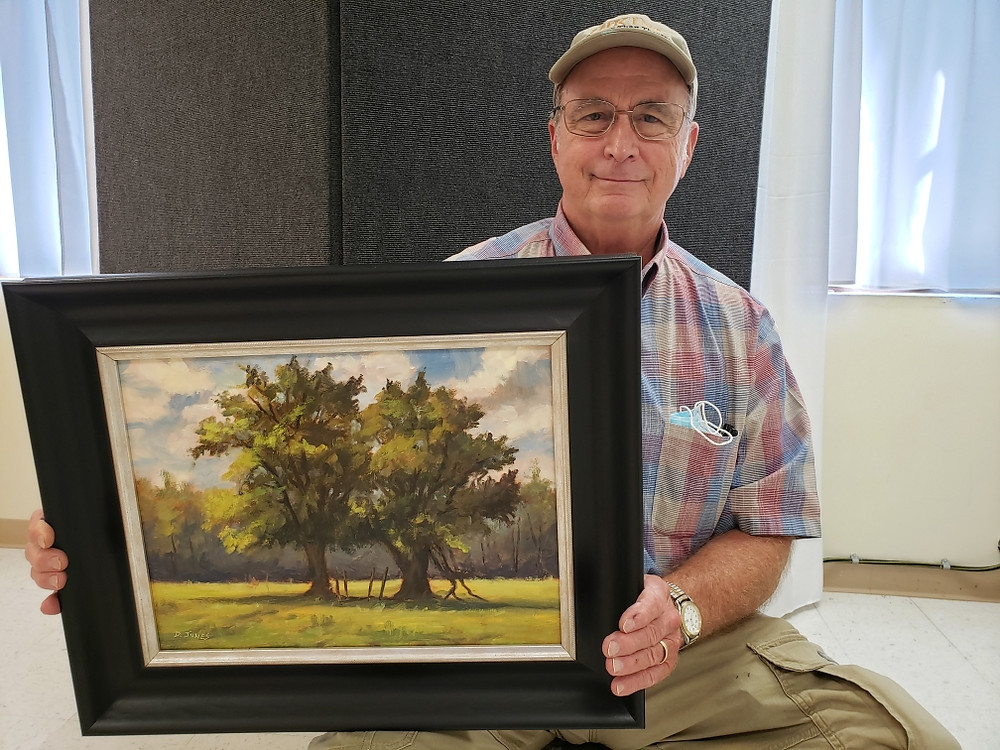 Pictured, David Jones shows off his painting, Twins on Wallahatchie, created during the 2020 Pike Road Plein Air Paint Out.