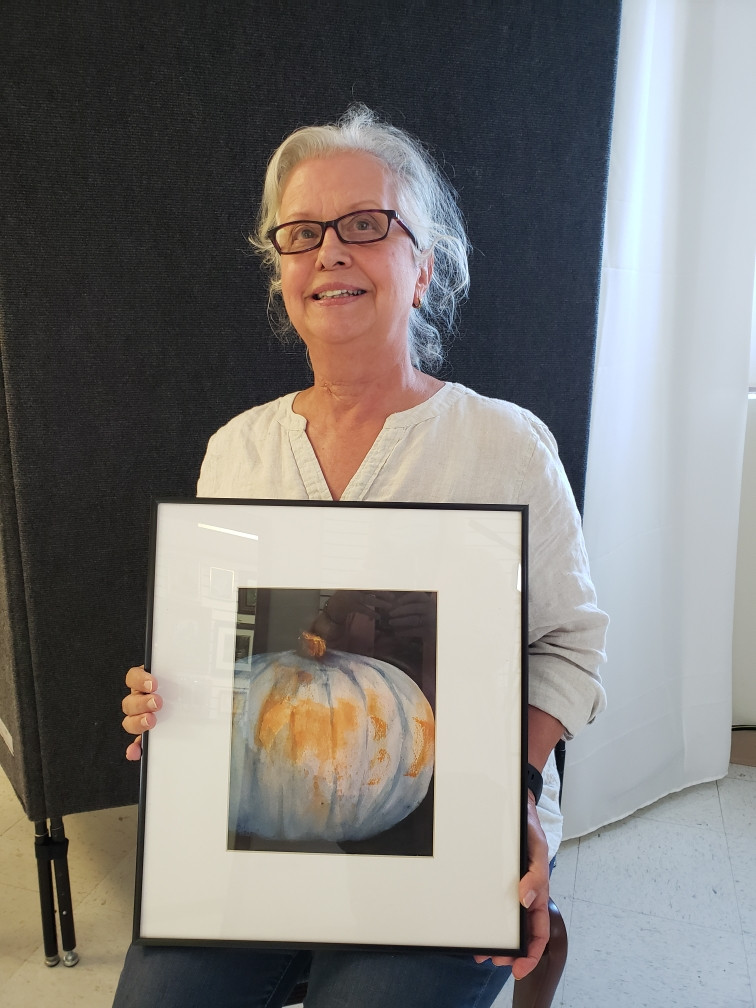 Pictured, Rhonda Hancock shows off her painting, Blue Pumpkin, created during the 2020 Pike Road Plein Air Paint Out.
