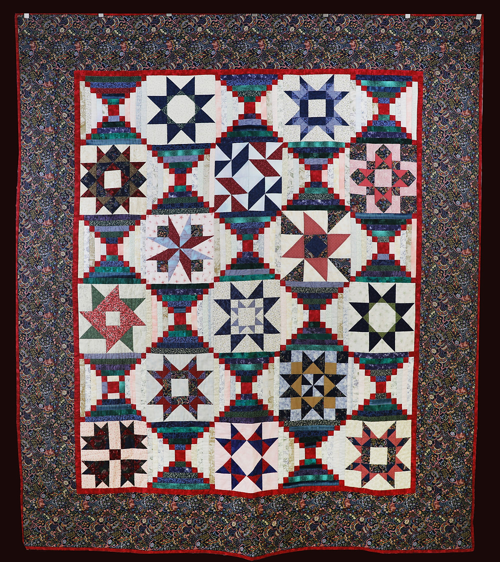 The Court House Steps Quilt by Evielean Howell