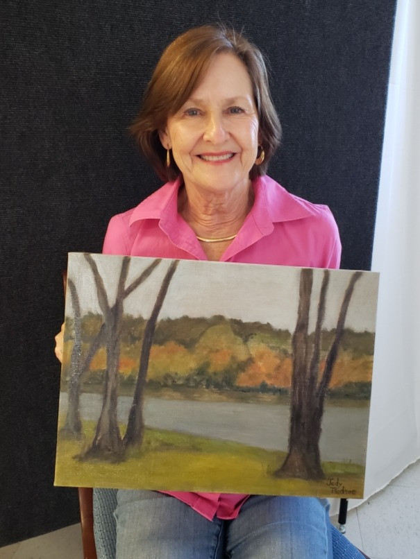 Pictured, Judy Bledsoe shows off her painting, Anne's Pond on an Autumn Day, created during the 2020 Pike Road Plein Air Paint Out!