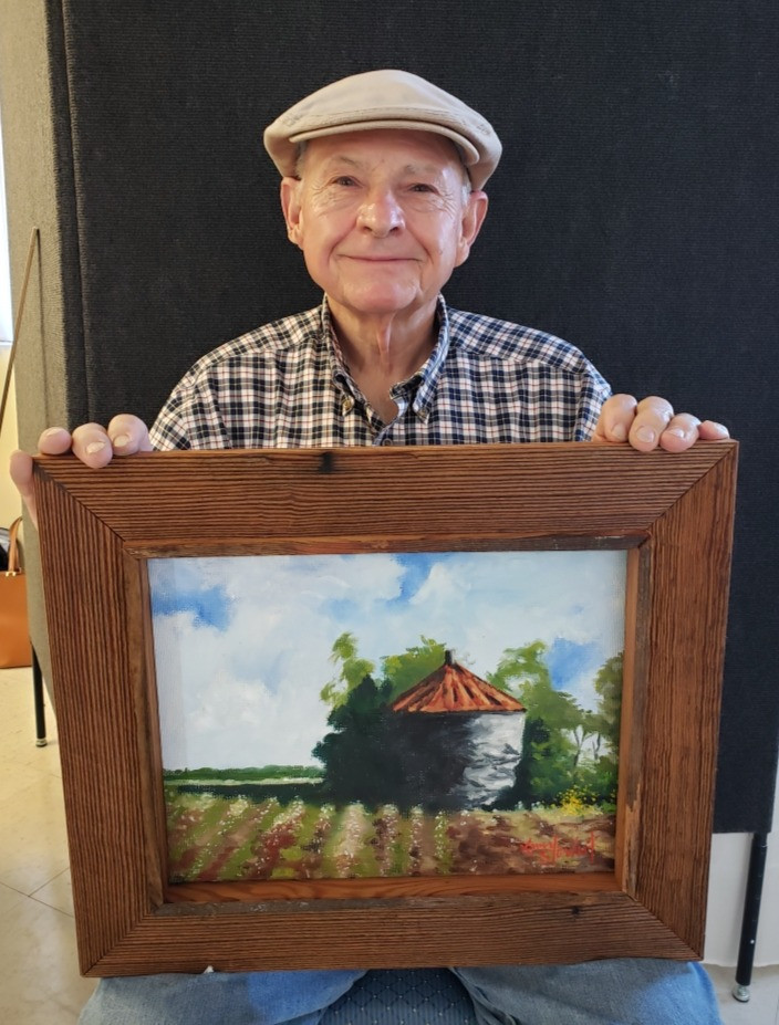Pictured, Larry Stewart shows off his painting, Harvest Silo, created during the 2020 Pike Road Plein Air Paint Out.