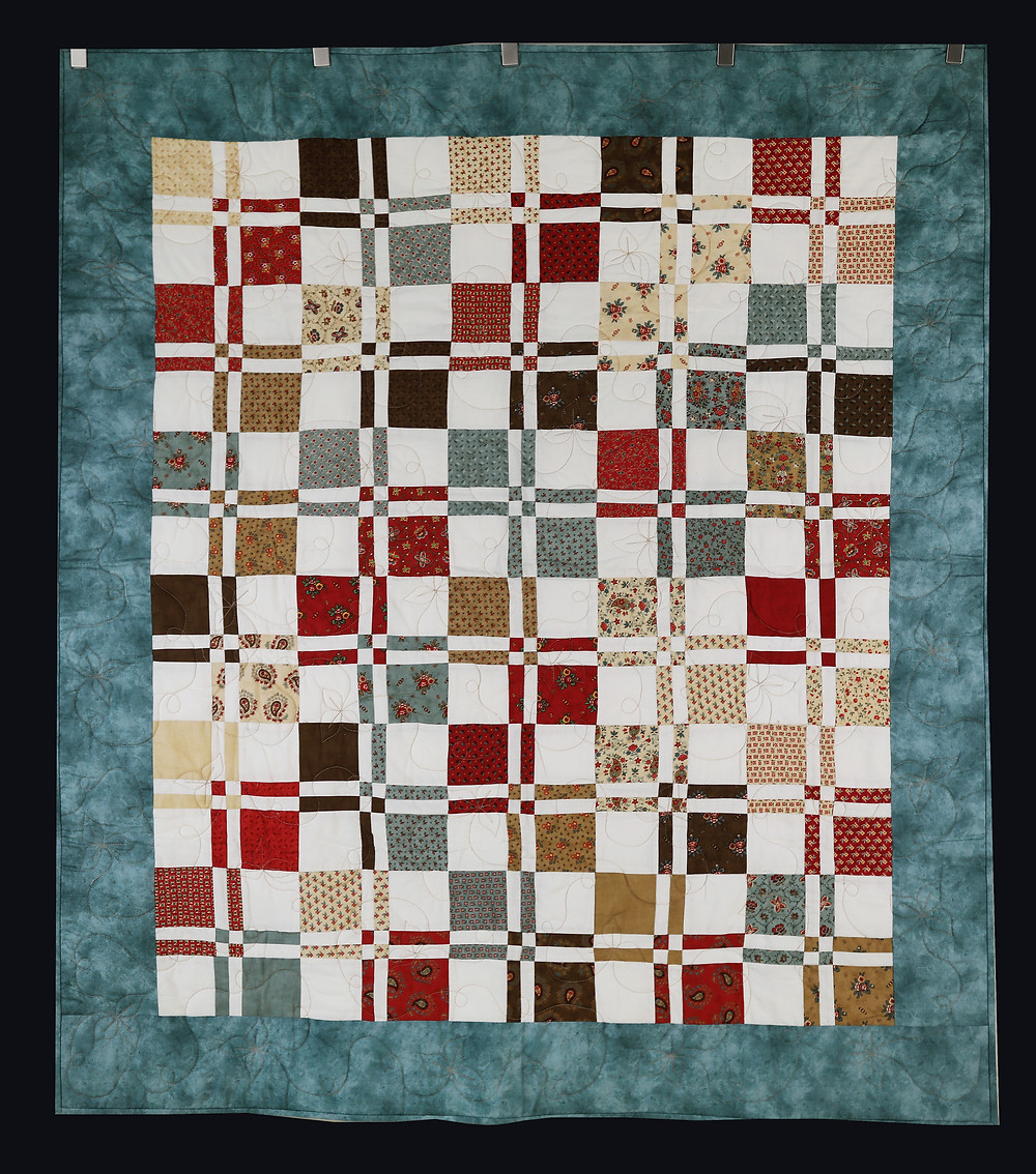 Disappearing Four-Patch Quilt by Dee Mueller