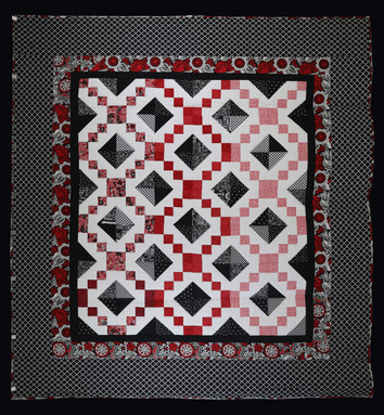 Red and Black Jewel Box Quilt by Charlene Howell Rabren