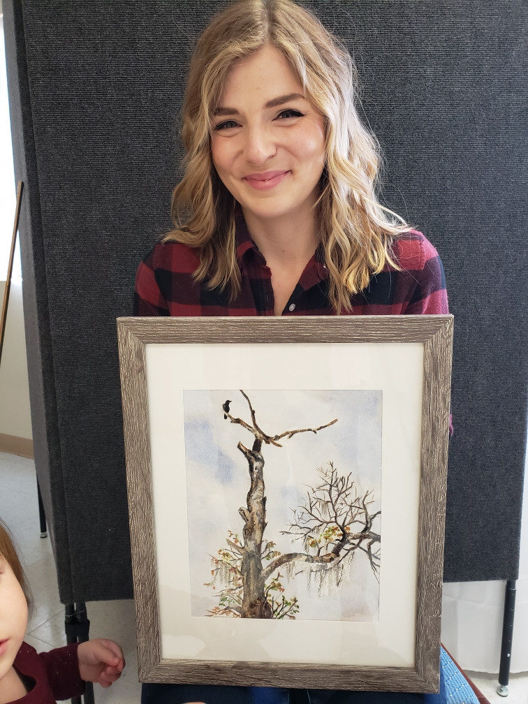 Pictured, Catie Daniel shows off her painting, The Perch, created during the 2020 Pike Road Plein Air Paint Out!