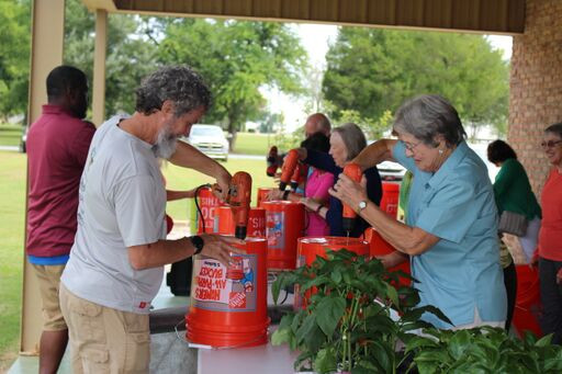Ag & Stewardship Club visitors create container gardens with everyday materials.