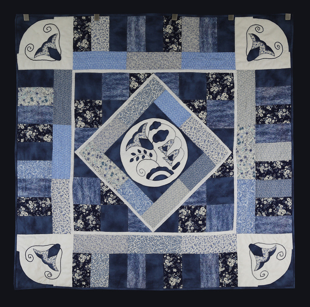 Symphony in Blue Wall Hanging Quilt by Charlene Howell Rabren and Evielean Howell