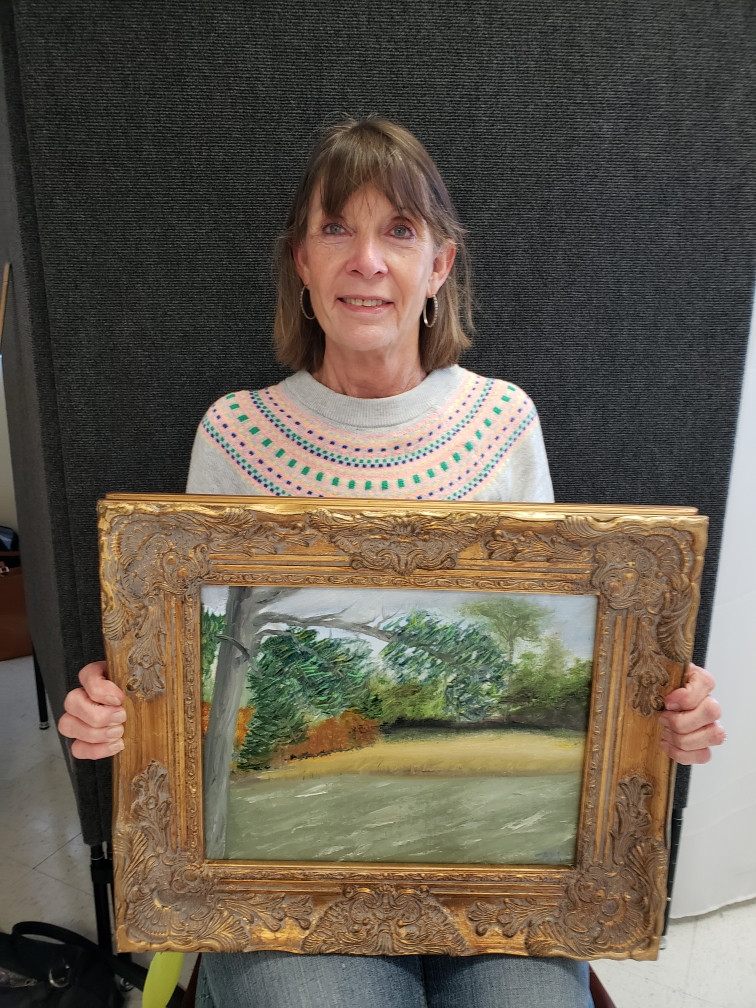 Pictured, Trish Gober shows off her painting, Pike Road Lazy Day, created during the 2020 Pike Road Plein Air Paint Out.