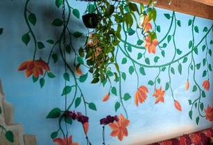 flowering vines against sky, older mural