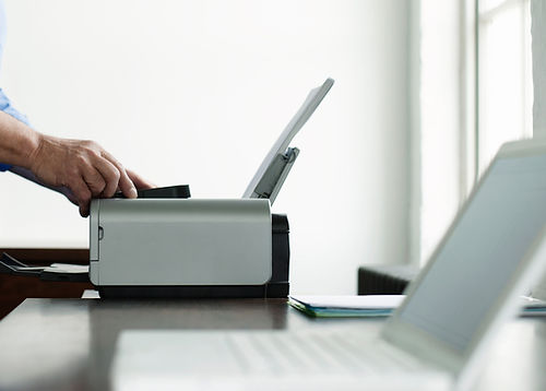 Man Using Computer Printer