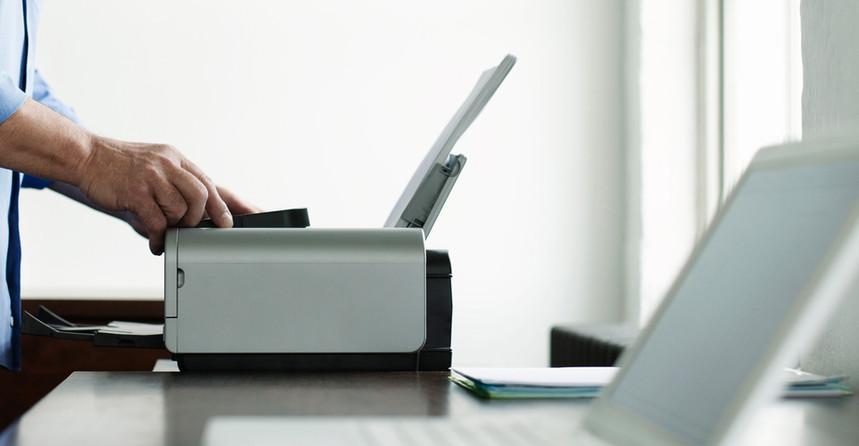 man-using-computer-printer