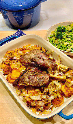 Tender Slow baked lamb shanks that fall right off the bone with sweet potatoes and onions