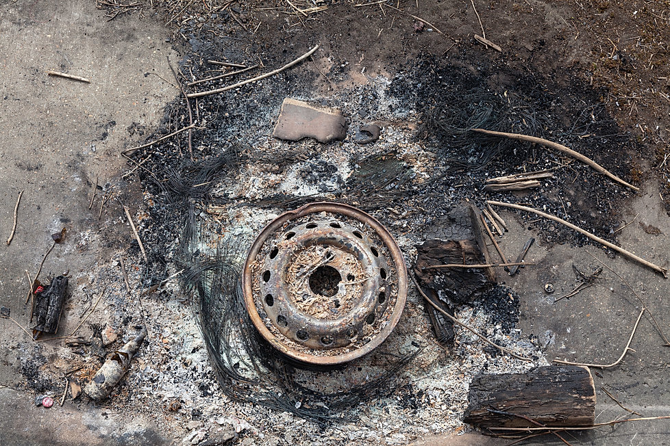 Car wheel and burnt out tyre remains.