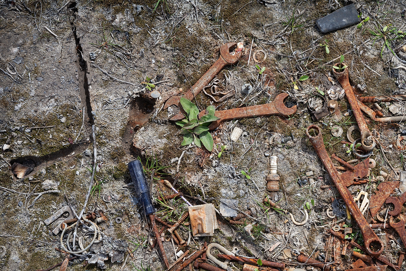Wheel wrench impression surrounded by rusted tools