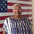 Veteran standing in front of flag