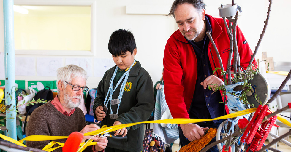 Volunteers Allen & Joel helping
