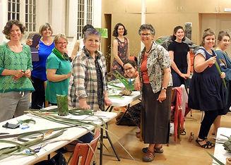 Happy people weaving baskets at Kickstart Arts