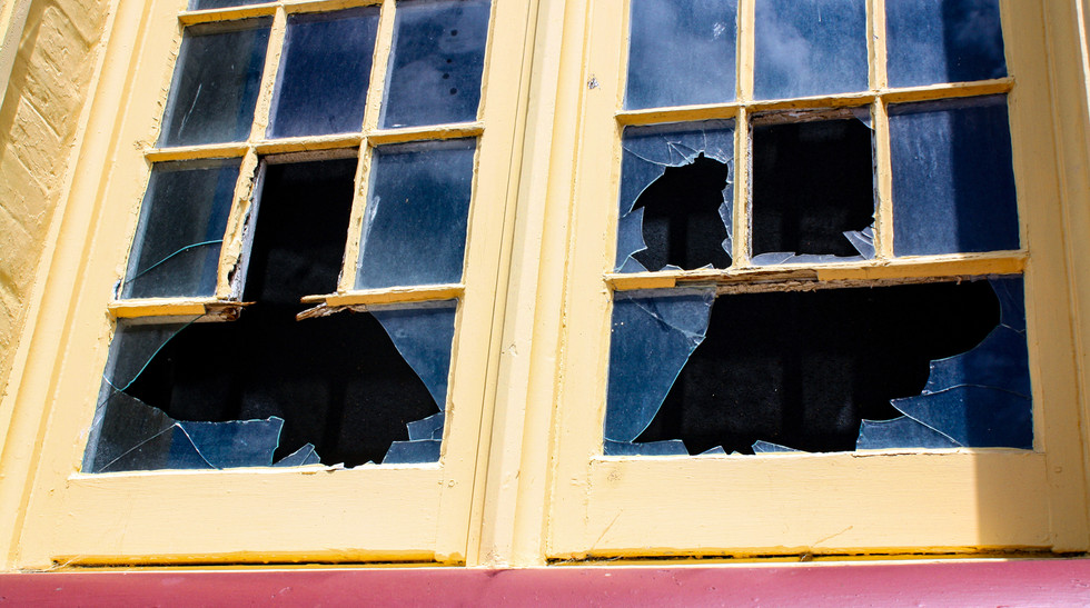 Broken window pre-renovation in boys orphanage