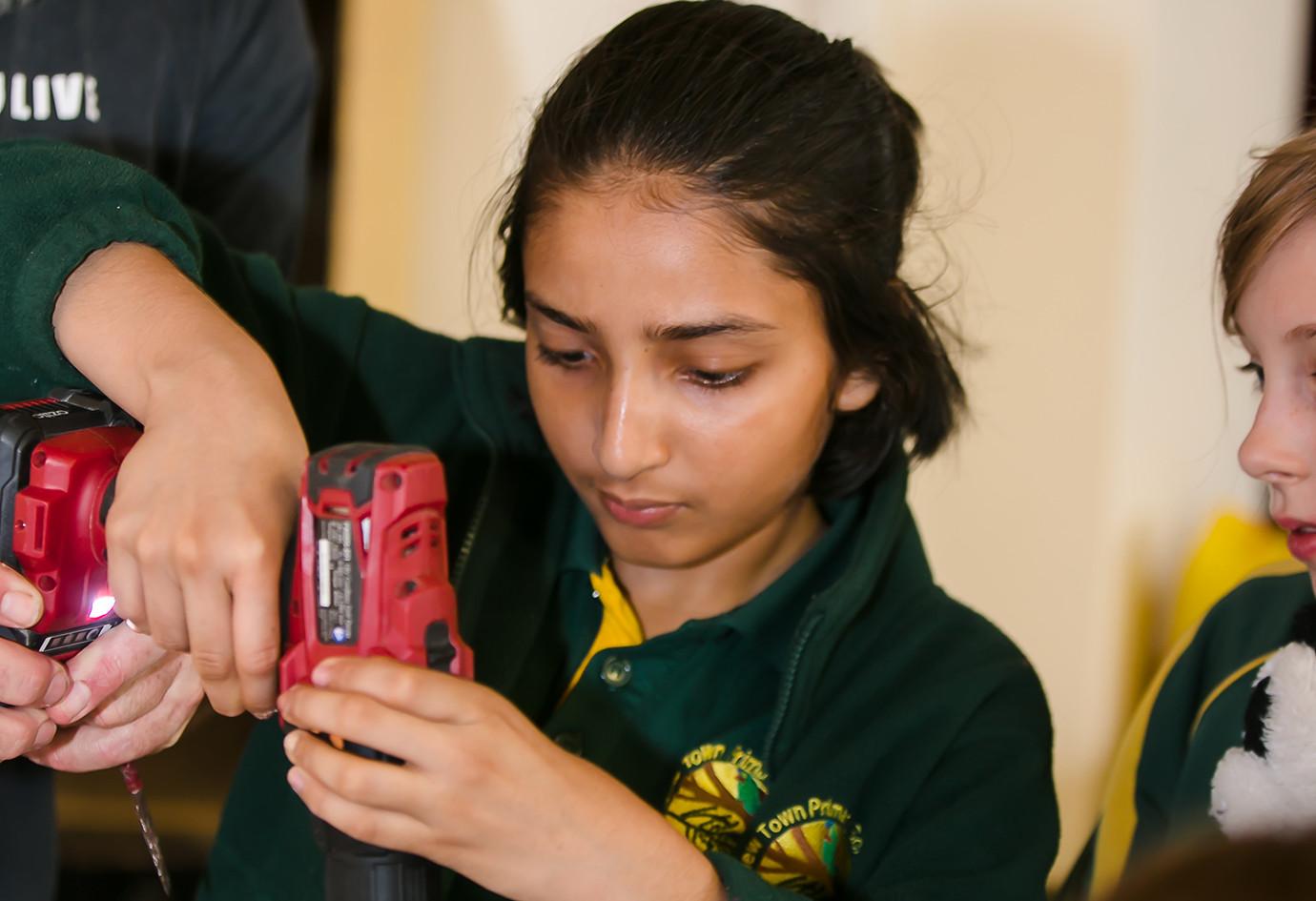 ReGenerate is girls using power tools (K