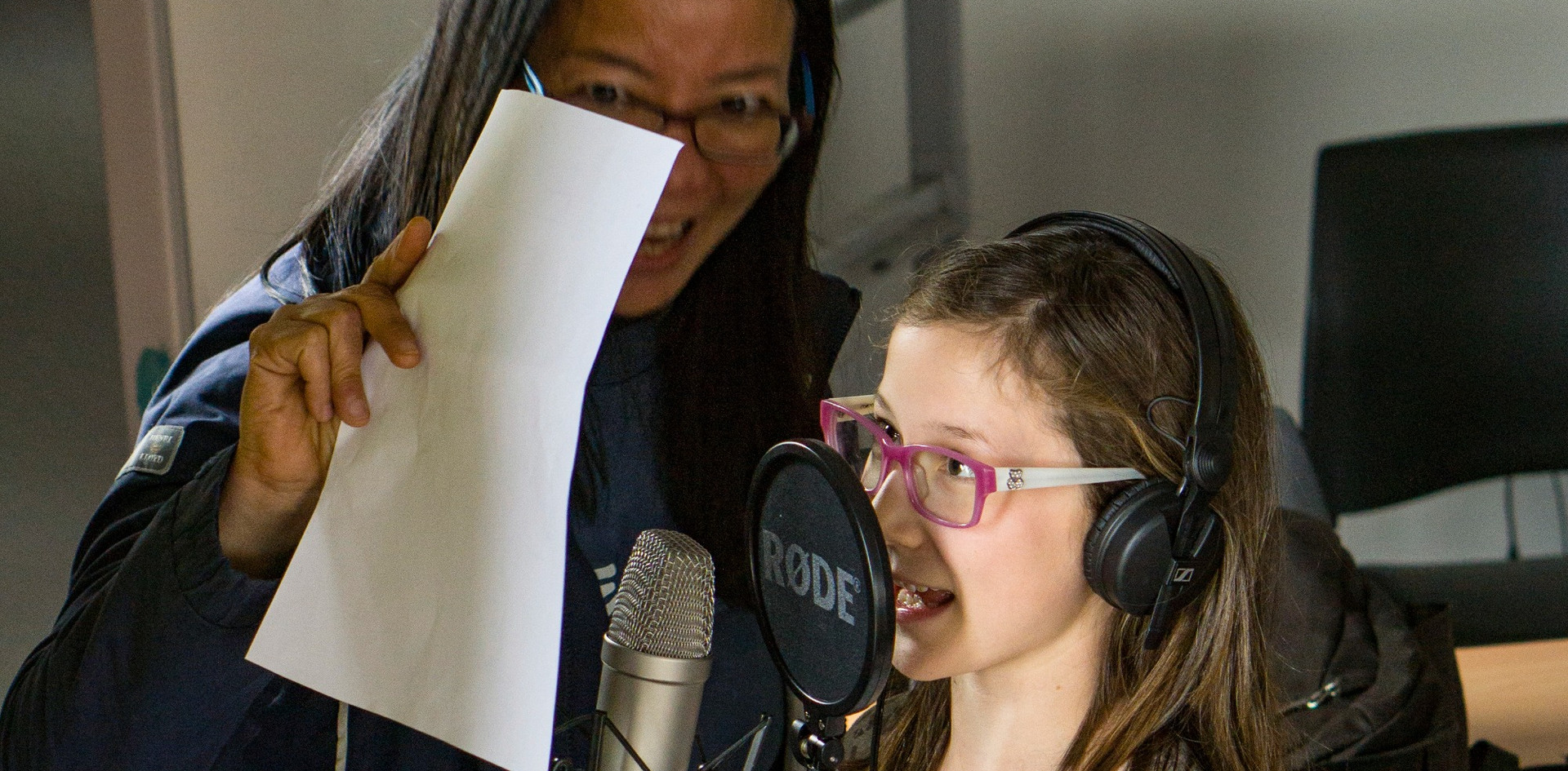 Young participant records her story
