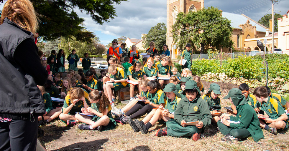 Children seated in Hobart City Farm