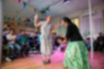 two women dance at Garden of Spring event