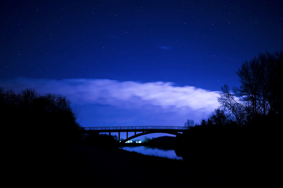 backlit-bridge-clouds-355599.jpg