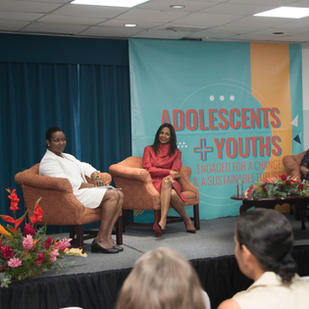 Haiti' s First Lady Martine Moise moderates a panel discussion at the Adolescents Forum in Belize