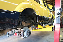 AER Auto & Truck Repair Waukesha WI skilled mechanic quality honest repairs complete satisfaction guaranteed truck with tire off brake repairs hoist