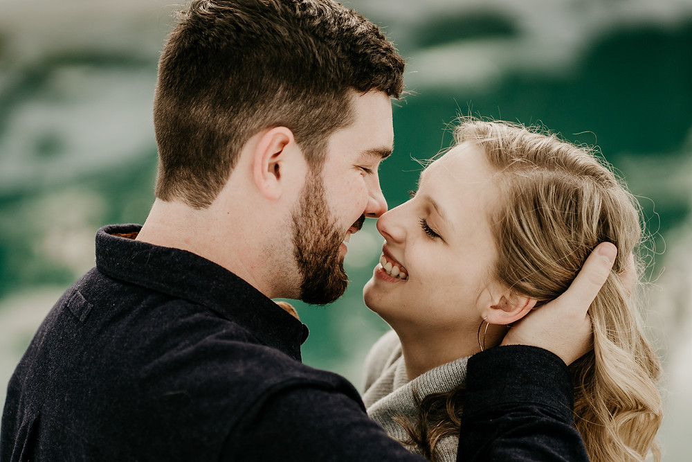man holding woman's head in his hand before kissing her