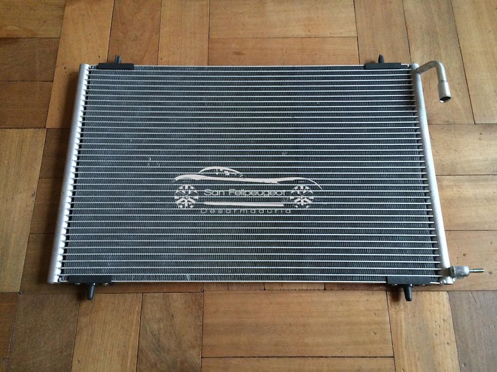 radiador aire acondicionado 206