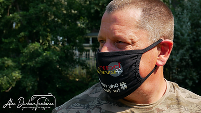 Man wear a bars 4 events mask in the countryside.
