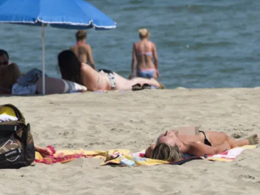 OUTRAGE AS TOPLESS WOMEN TOLD TO COVER UP ON FRENCH BEACH