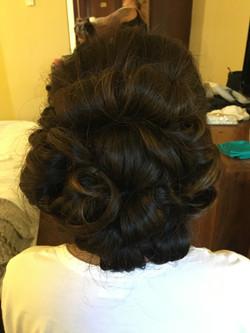 barrel curl bun hairstyle