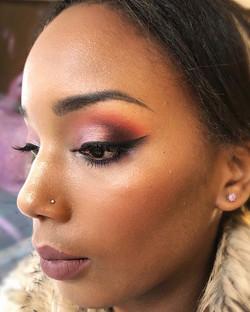 colourful glamour makeup on darker skin