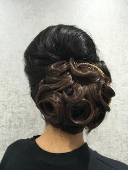 Asian bridal low bun hairstyle