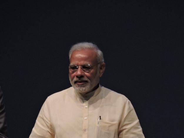 Prime Minister Narendra Modi releasing the book on Auroville's 50th anniversary, 2018.