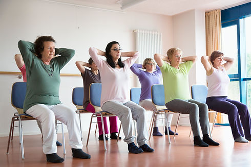 active-senior-women-yoga-class-on-chairs