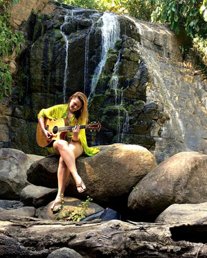 Taylor Lamborn Playing at a Waterfall