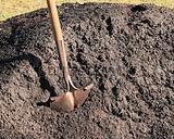 rusty-garden-shovel-pile-topsoil-450w-95