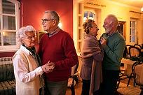 Two senior couple dancing romatic at nursing home, senior party at home.jpg